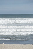 Turbulent sea at Mount Maunganui Main Beach,  Tauranga New Zealand