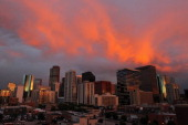 Turbulent weather produced a spectacular sunset over the skyline of the Denver downtown as seen from the stadium as the Milwaukee Brewers face the...