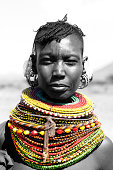 A Turcana tribeswoman in traditional beadwork. Lake Turcana, Kenya. Destaurated apart from her beadwork.