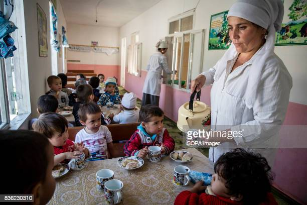 Turdenisa Khydyraieva provides boiled water and cookies to children at a kindergarten in Beshkent Kyrgyzstan where water is gathered from an...