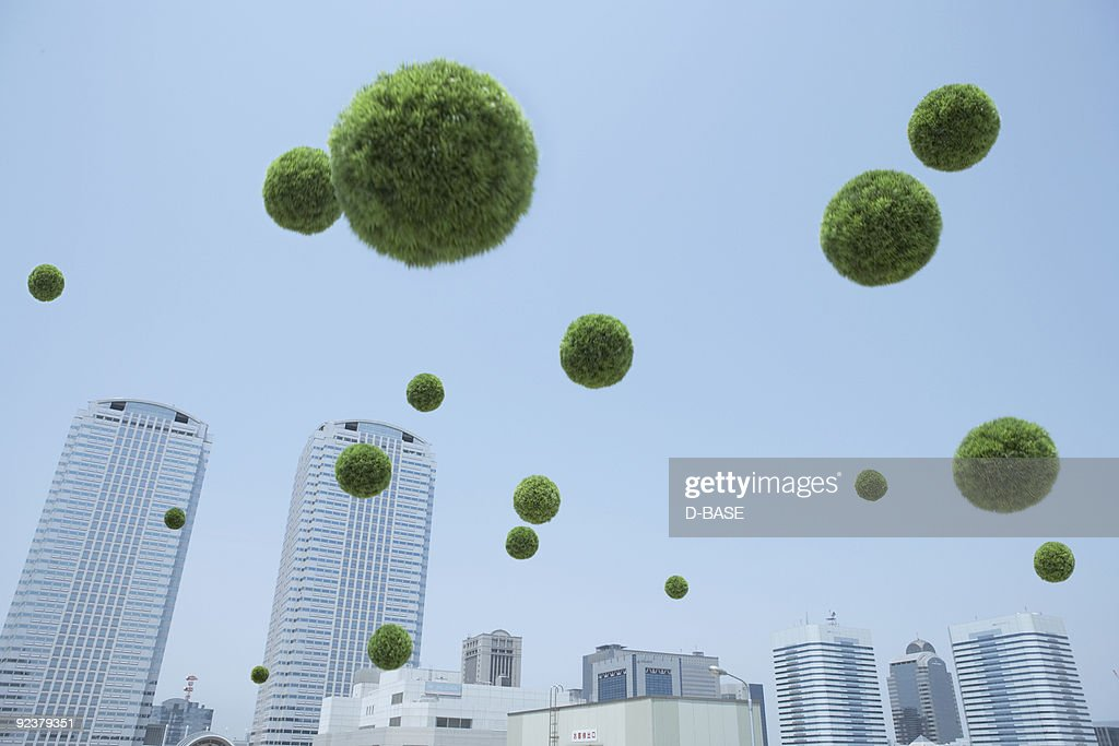 Turf ball flying mid-air, low angle view : Stock Photo
