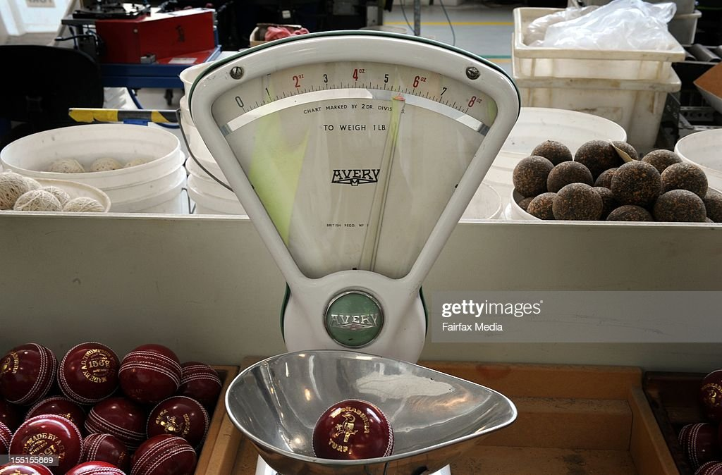 Turf balls are weighed at the Kookaburra cricket ball factory at Moorabbin in Melbourne, October 24, 2012. Each ball must weigh 156 grams. This iconic manufacturer of Australian cricket balls is angered that Cricket Australia intends to introduce the English-made Dukes balls into domestic games. Kookaburra has virtually monopolised the local cricket ball market for the past 122 years. (Photo by Penny Stephens/Fairfax Media/Fairfax Media via Getty Images).