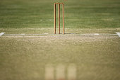 A general view of a cricket pitch and stumps  are seen during a break in play of a cricket match