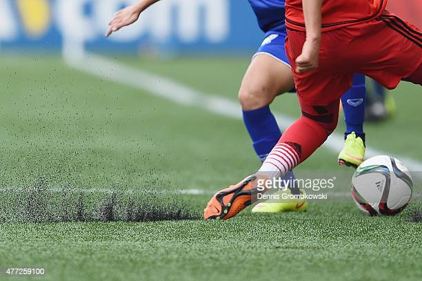 Turf is seen during the FIFA Women's World Cup Canada 2015 Group B match between Thailand and Germany at Winnipeg Stadium on June 15 2015 in Winnipeg...