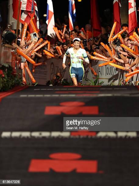 Turia Pitt of Australia crosses the finish line in the 2016 IRONMAN World Championship triathlon on October 8 2016 in Kailua Kona Hawaii