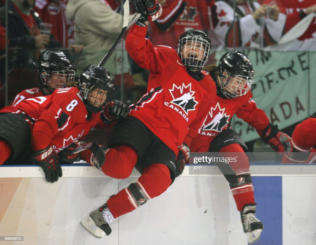 Canadian Gillian Apps (C) and teammates jumps out of the bench at the end of the ice hockey women's gold medal game Sweden vs Canada at the 2006 Winter Olympics, 20 February 2006 at the Palasport Olimpico in Turin. Canada won the gold, Sweden the silver and USA the bronze.
