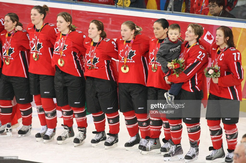 Canadians hockey players pose with their gold medals at the end of the ice hockey women's gold medal game Sweden vs Canada at the 2006 Winter Olympics, 20 February 2006 at the Palasport Olimpico in Turin. AFP PHOTO DON EMMERT