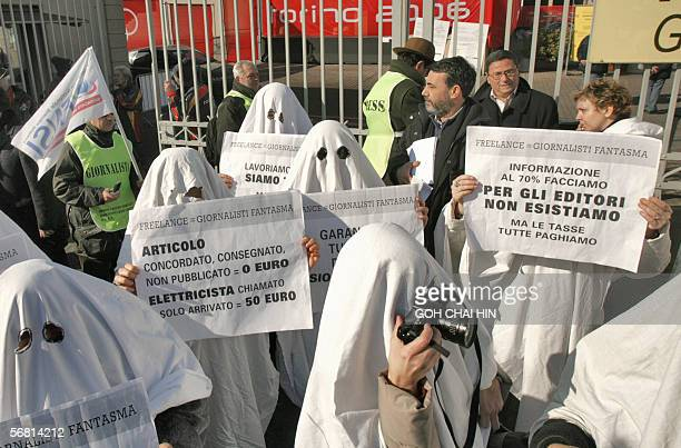 Freelance journalists dressed up as ghosts demonstrate in front of one of the entrance of the Main Press Cente few hours before the opening ceremony...