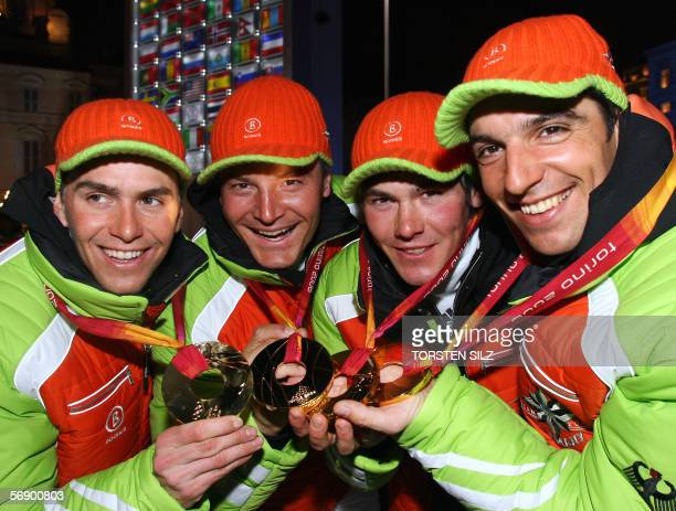 Gold medallists Ricco Gross Michael Roesch Sven Fischer and Michael Greis from Germany pose with their medals 21 February 2006 following the Men's...