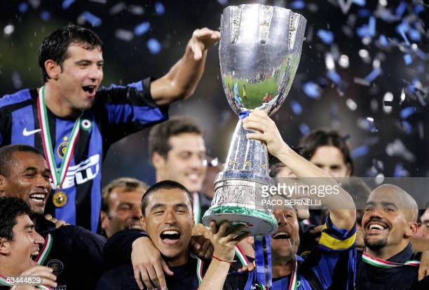 Inter Milan's capitan defender Javier Zanetti celebrates the Italian Super Cup with his teammates Ze Maria Dejan Stankovic Ivan Ramiro Cordoba and...