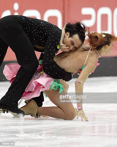 Italian pair Barabara Fusar Poli and Maurizio Margaglio fall in the Ice Dancing Original Dance event during the Figure Skating competition at the...