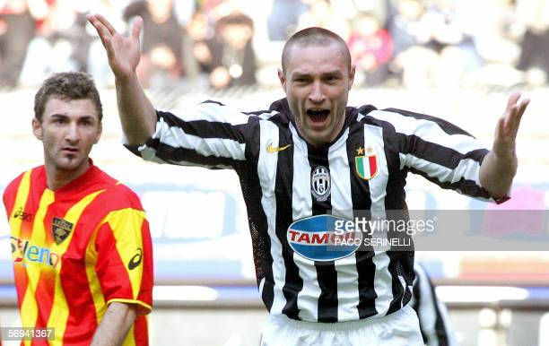 Juventus' defender Robert Kovac celebrates after scoring a goal next to Lecce's forward Gennaro Del Vecchio during their Serie A football match...