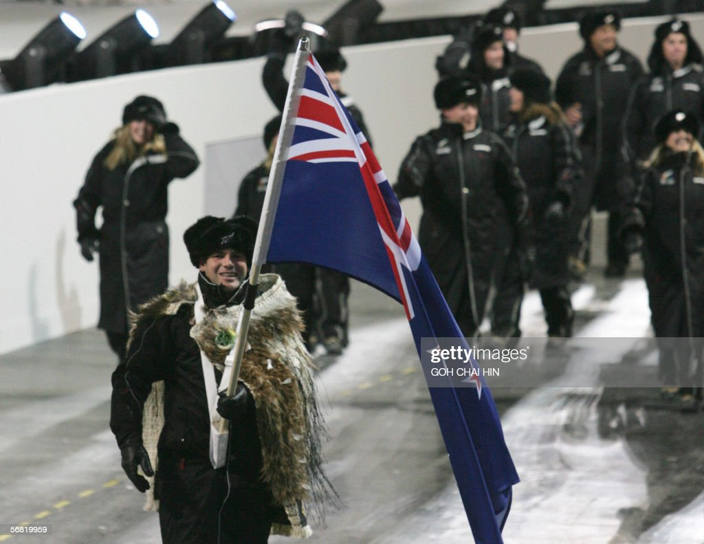 NewZealand's athlete Sean Becker parades with the national flag during the opening ceremony of the 2006 Winter Olympics at the Stadio Olympico in...