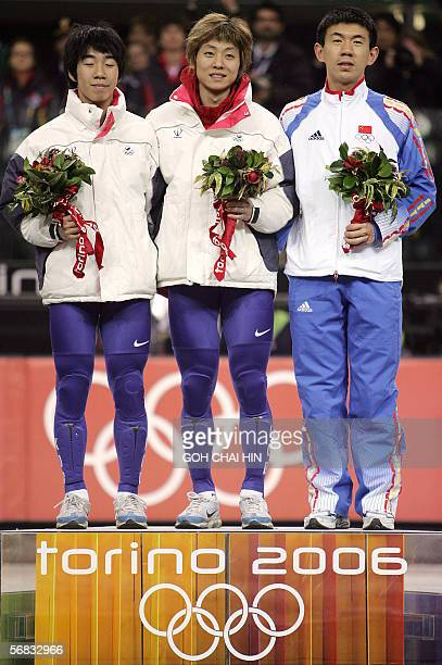 South Korea's Ahn HyunSoo his compatriot Lee HoSuk and China's Li JiaJun pose on the podium of the Short Track Men's 1500m competition at the 2006...