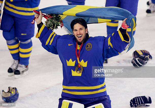 Sweden's golkeeper Henrik Lundqvist celebrates after his team won the 2006 Winter Olympic ice hockey gold medal game between Finland and Sweden 26...