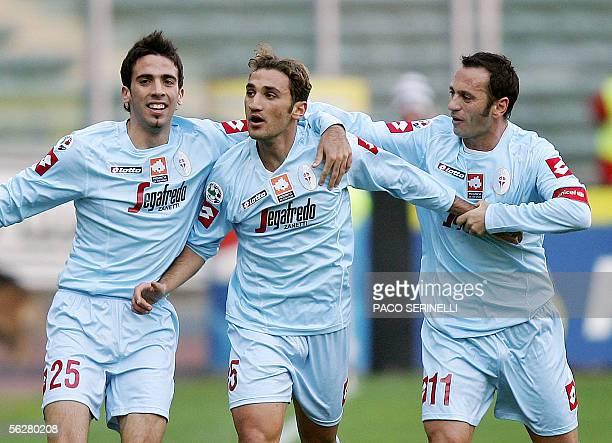 Treviso's midfielder Francesco Parravicini is congratulated by teammates Hernan Dellafiore and Fabio Gallo after scoring a goal against Juventus...