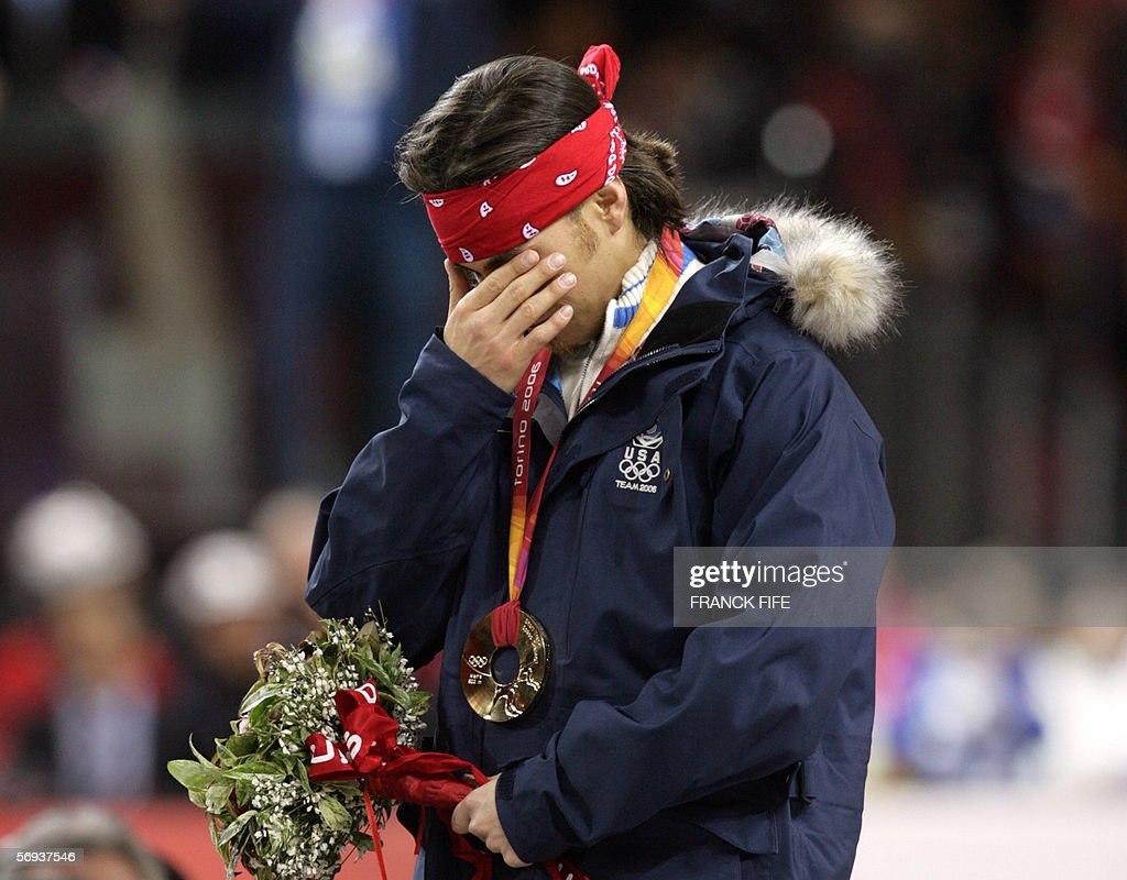 US Apollo Ohno cries on the podium after winning the gold medal of the men's 500m race during the short track competition at the 2006 Winter Olympics, 25 February 2006 at the Palavela in Turin. Canada's Francois-Louis Tremblay takes the silver medal and South Korea's Ahn Hyun-Soo placed third.