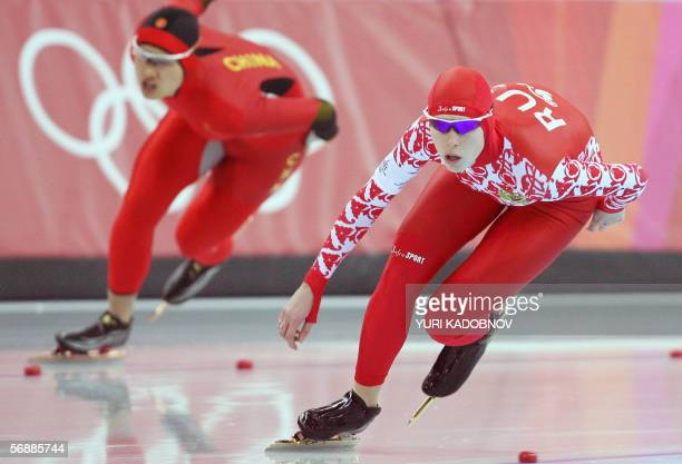 Yekaterina Lobysheva of Russia and Ren Hui of China skate during the Ladies' 1000m speed skating competition at the 2006 Winter Olympics 19 February...