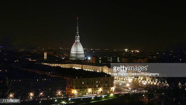 Turin skyline at night with illuminated Mole