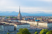 Turin skyline at sunset, Torino, Italy, panorama cityscape with the Mole Antonelliana over the city. Scenic colorful light and dramatic sky.