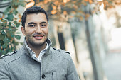 Portrait od smiling gorgeous young attractive man, outdoor - outside coldly morning