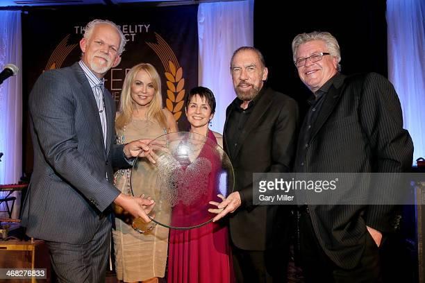 Turk Pipkin Eloise DeJoria Christy Pipkin John Paul DeJoria and Ron White pose with the Ann Richards Founders Award that was presented to John Paul...