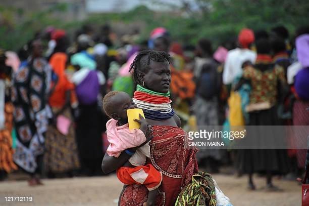A Turkana woman holds her baby as she waits for supplimentary feeding for infants at a relief and health centre in Kakuma Turkana District...