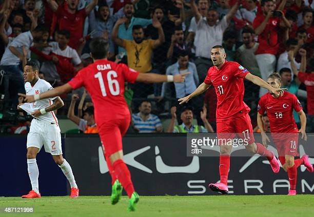 Turke's Burak Yilmaz celebrates with his teammates after scoring a goal during the Euro 2016 qualifying football match between Turkey and Netherlands...