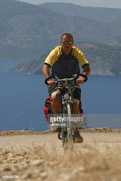 A man during a bicycle tour in the mountains