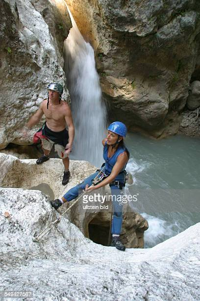 A woman and a man during a climbing tour in the mountains at a mountain lake