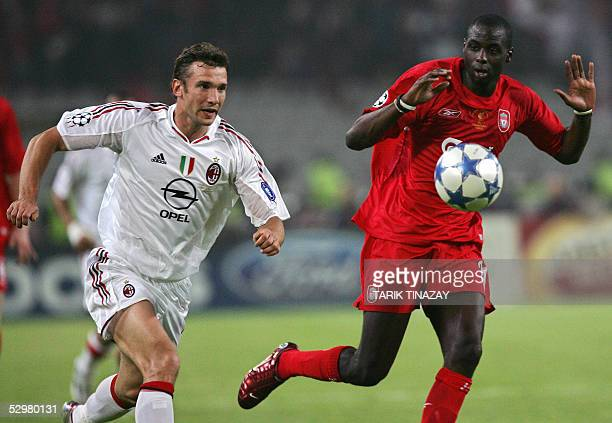 AC Milan's Ukrainian forward Andriy Shevchenko fights for the ball with Liverpool's French defender Djimi Traore during the UEFA Champions League...