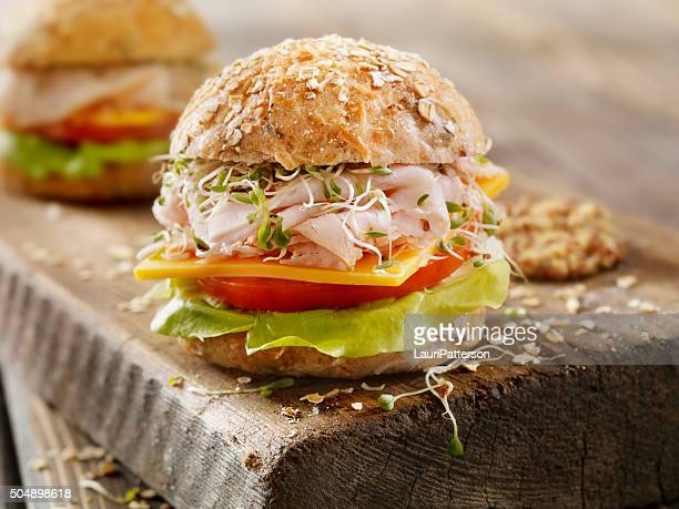 Turkey and Cheese Sandwich on a Rustic Cutting Board