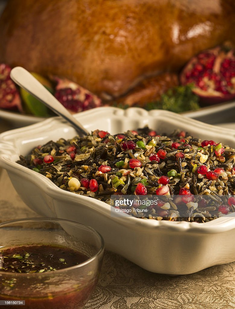 A turkey and grain salad with pomegranate seeds came make a good side dish at Thanksgiving.