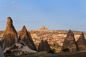 Turkey, Eastern Anatolia, Cappadocia, fairy chimneys at Goereme National Park in front of the villages Goereme and Uchisar