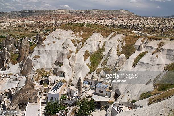 Turkey Cappadocia Goreme Looking down on a cave hotel built into the white tufa rock with the Red Valley behind