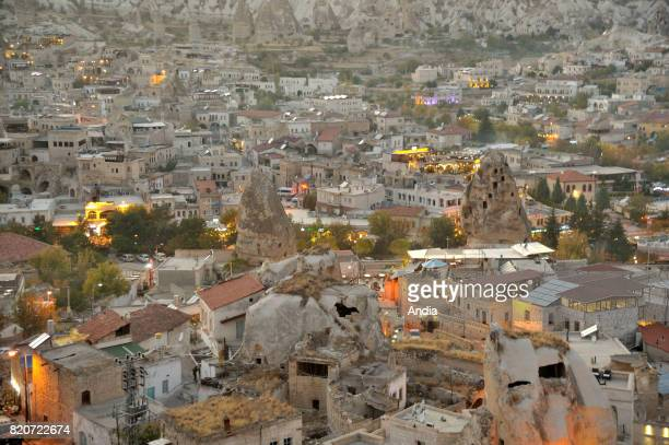 overview of the city and the valley of Goreme below at nightfall