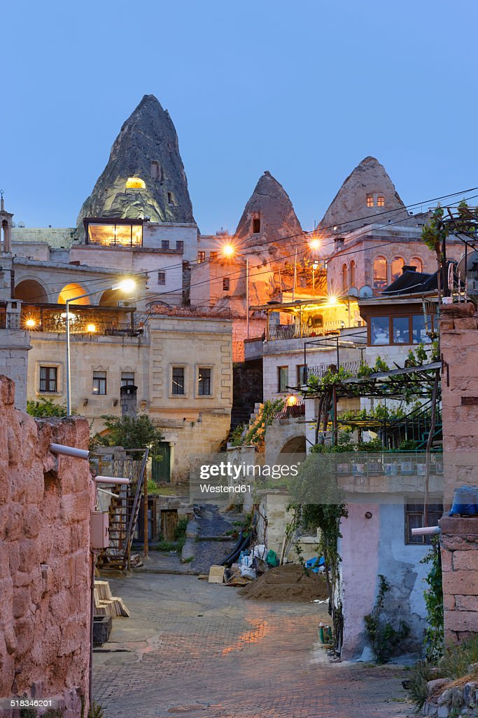 Turkey, Eastern Anatolia, Cappadocia, Fairy chimneys at Goereme National Park, Houses in Goereme in the evening