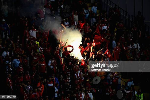 Turkey fans let off flares during the UEFA EURO 2016 Group D match between Czech Republic and Turkey at Stade BollaertDelelis on June 21 2016 in Lens...