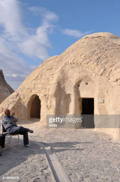Turkey Goreme OpenAir Museum with churches carved out from stone and troglodyte dwellings Watchman on his chair