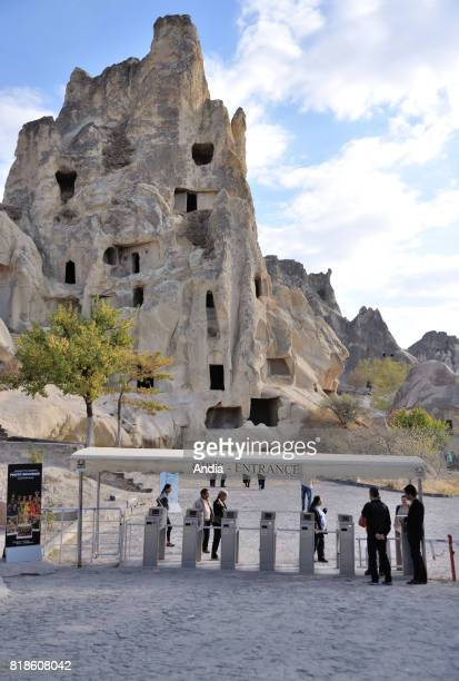 Turkey Goreme OpenAir Museum with churches carved out from stone and troglodyte dwellings Tourists at the entrance to the site going through the...