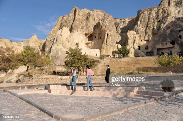 Turkey Goreme OpenAir Museum with churches carved out from stone and troglodyte dwellings Group of tourists visiting the site