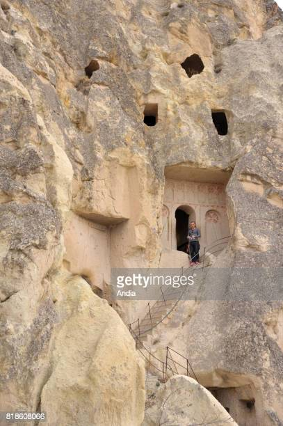 Turkey Goreme OpenAir Museum with churches carved out from stone and troglodyte dwellings Red Templar Cross on a wall