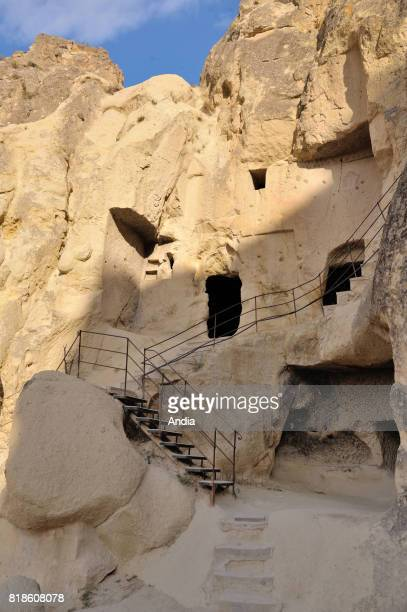 Turkey Goreme OpenAir Museum with churches carved out from stone and troglodyte dwellings Tourists on visit
