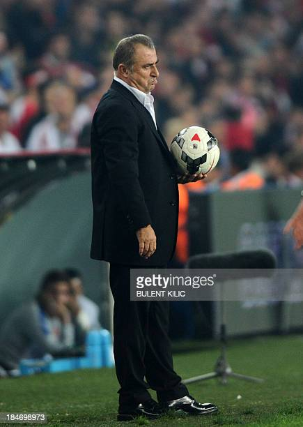 Turkey head coach Fatih Terim reacts on October 15 2013 after a FIFA 2014 World Cup qualifying football match against Netherlands at the Sukru...