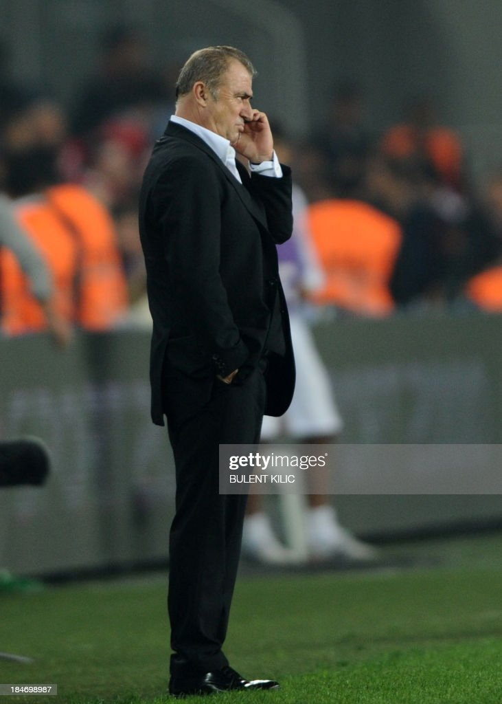 Turkey head coach Fatih Terim reacts on October 15, 2013 after a FIFA 2014 World Cup qualifying football match against Netherlands at the Sukru Saracoglu Stadium in Istanbul.