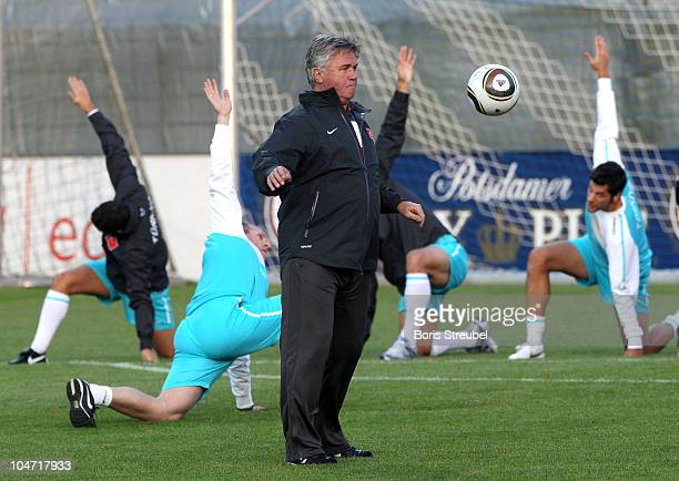 Turkey head coach Guus Hiddink controls the ball during the Turkey training session at KarlLiebknecht stadium on October 4 2010 in Potsdam Germany