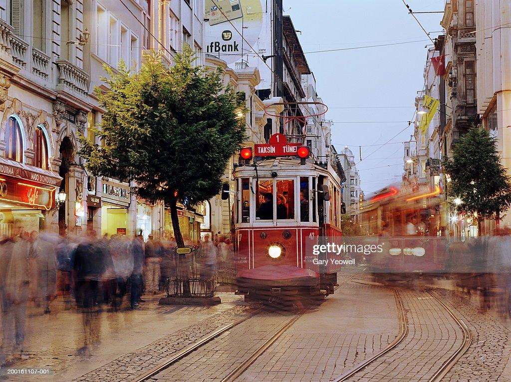Turkey, Istanbul, Beyoglu, Taksim, trams in street (blurred motion)