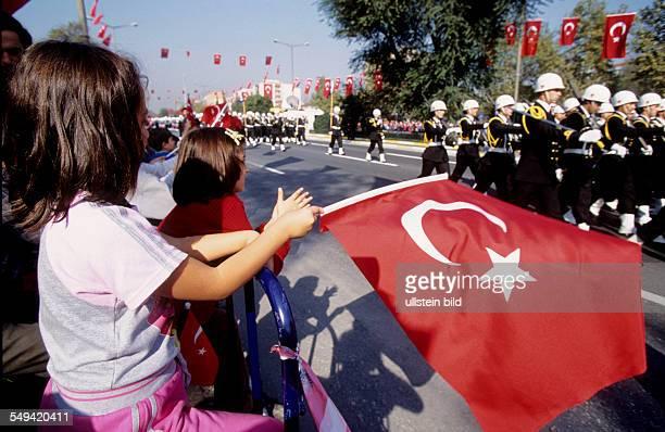 mitliary parade for the 81th anniversary of the Turkey Turkish girl watching the parade