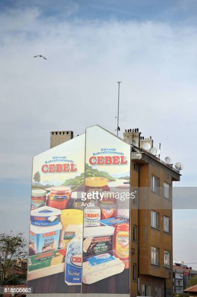 Konya Advert for the local food brand 'Cebel' painted on the gable of a small building Satellite dishes and blue sky