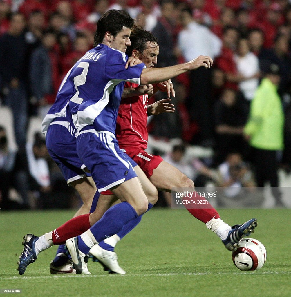 Turkey midfielder Tuncay Sanli vies with Georgios Seitaridis of Greece during their World Cup 2006 qualifier at Inonu Stadium Istanbul 04 June 2005...
